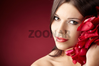 Portrait of the pretty girl with the red petals