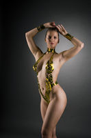 Nude blonde her body covered with gold tape