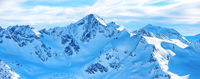Panorama of winter mountains in snow