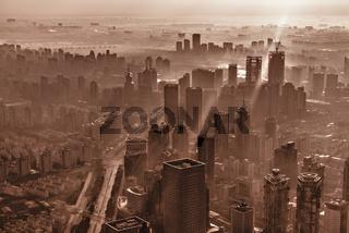 Smoke above Shanghai city center at sunrise time.