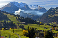 Smoke of fall fires in the Bernese Oberlandthe near Gstaad, Bernese Oberland, Switzerland