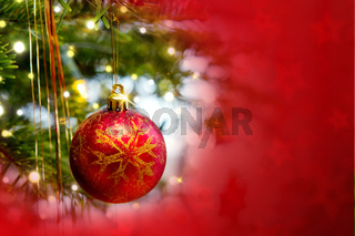 Christmas ball isolated on red background.