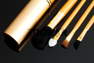 cosmetic brushes on black background