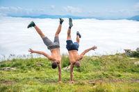 Two men dancing and making acrobatic tricks