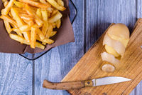 Potato peeled and cutted by hand with knife and french fries