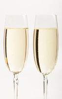 Two flutes with champagne isolated on white background