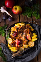 Chicken pieces with fruit and vegetables