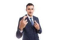 Banker or broker smiling with  fingers crossed