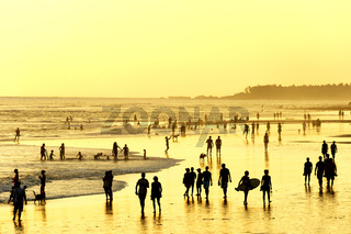 People walking on  beach. Bali