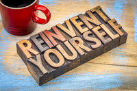 reinvent yourself - motivational words in wood type