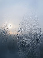 Water drops and sunlight on window glass