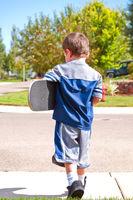 Little boy ready to skateboard