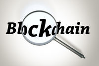 magnifying glass and the word Blockchain