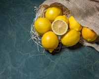 Fresh lemons stacked on hessian sack