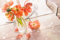 Overhead shot of spring tulips on wood table