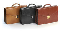 Different briefcases on a white background. Briefcase shop or marketing concept.