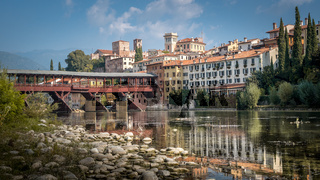 Bassano del Grappa with river Brenta and bridge Ponte degli Alpini in Vicenza, Italy