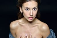 Torso portrait of the beautiful woman with naked shoulders
