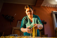 40 year old woman prepares fresh egg pasta homemade noodles