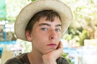 portrait of a young man with straw hat