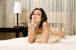 Naked woman in a bed