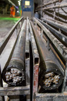 Drilling heads for tunneling machinery