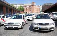 Lots of white taxis