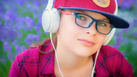 Cute girl listening to music with headphones outdoor