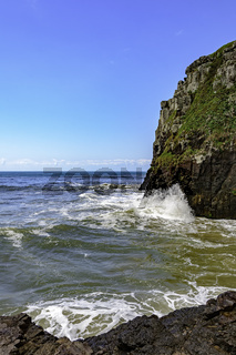 Cliff over sea and waves