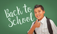 Thumbs Up Hispanic Boy in Front of Back To School Chalk Board