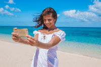 Woman doing selfie on beach