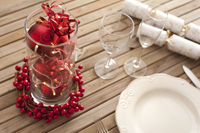 Christmas table setting with red decorations