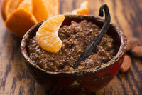 A bowl of chocolate tapioca pudding with fruits