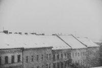winter panorama, snowing on city skyline