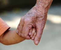 Grandfather holding hand of his grand