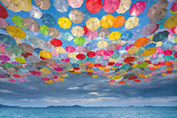 Abstract design of umbrellas flying in the sky