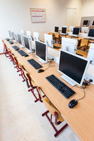 Computer lab with rows of computers in school