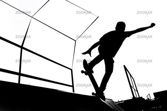 Black and white skater silhouette illustration on the ramp