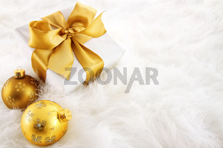 Gold ribboned gifts with christmas ornaments