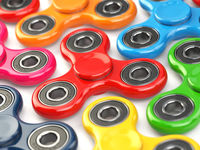 Group of fidget finger spinner stress, anxiety relief toy.