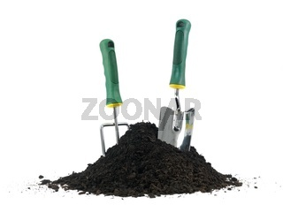 Garden soil and implements isolated against a white background