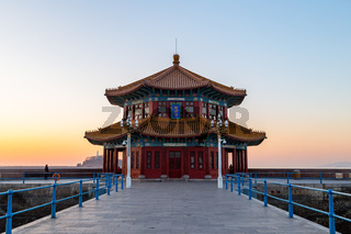 Zhanqiao pier at sunrise, Qingdao, Shandong, China. The name 'Huilan Pavilion' is engraved above the entrance door.