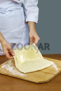 Woman rolls squeezes dough Handmade Series Food recipes