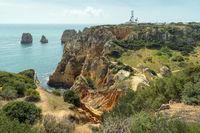 The rock Algarve at Ponta da Piedade with lighthouse and radar station