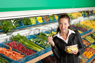 Grocery store shopping - Business woman buying fruit salad
