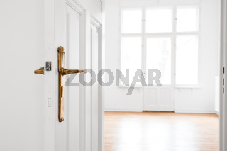 open door, empty room in renovated old flat