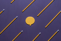 Speech bubble surrounded by wooden pencils
