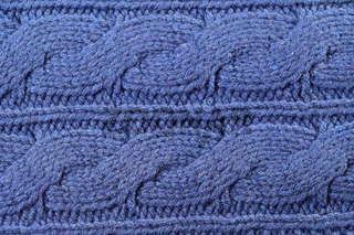Blue knitted texture with ornament braids