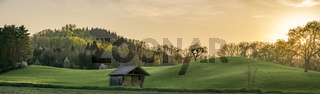 Sunset panorama with green hills in Germany