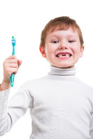 Boy without baby teeth with toothbrush